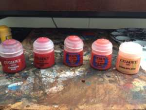 When it comes to red pigments, I have had the best experiences with the GW range, though there are several good ones out there